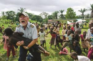 Jon Cadd plays with children at Nebobongo hospital mission stati