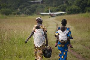 Women walk toward a plane. Photo used for the 2014 MAF US Calendar.